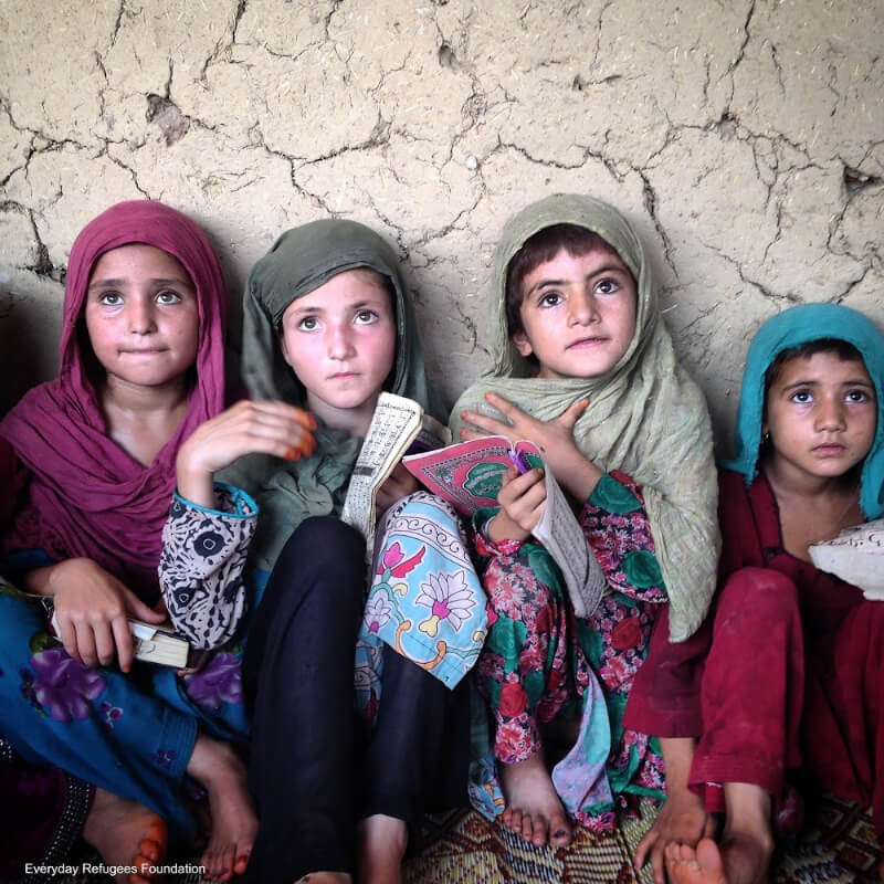 """""""Afghan refugee girls attending a class at a makeshift school in Pakistan"""". Photo by Muhammed Muheisen/Everyday Refugees Foundation."""